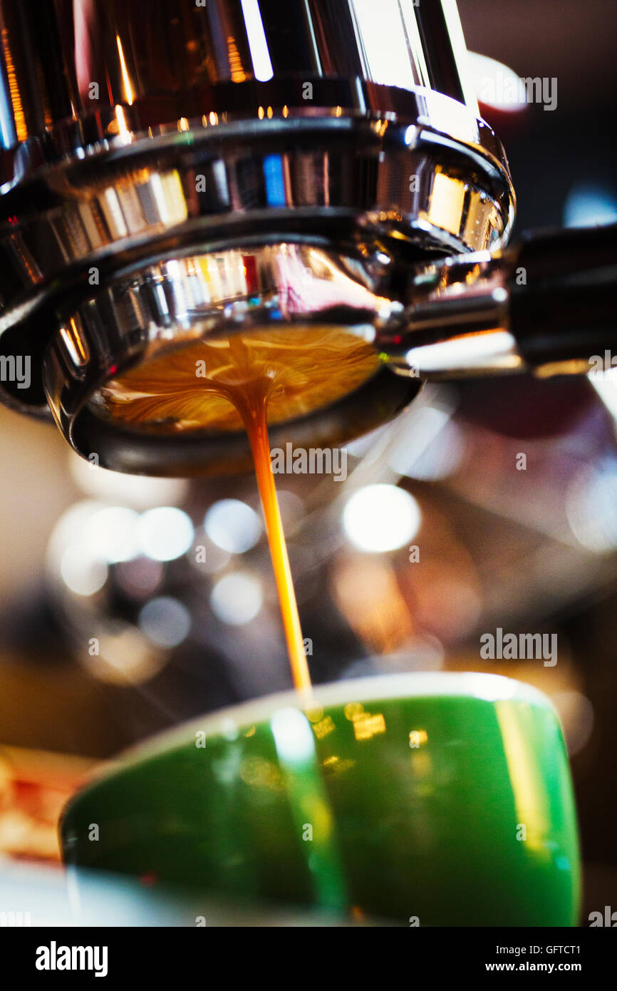 Freshly brewed coffee flowing into a coffee cup - Stock Image
