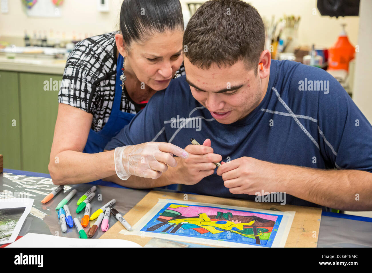 Las Vegas, Nevada - People with intellectual disabilities in the Fine Art Program at the nonprofit Opportunity Village. - Stock Image