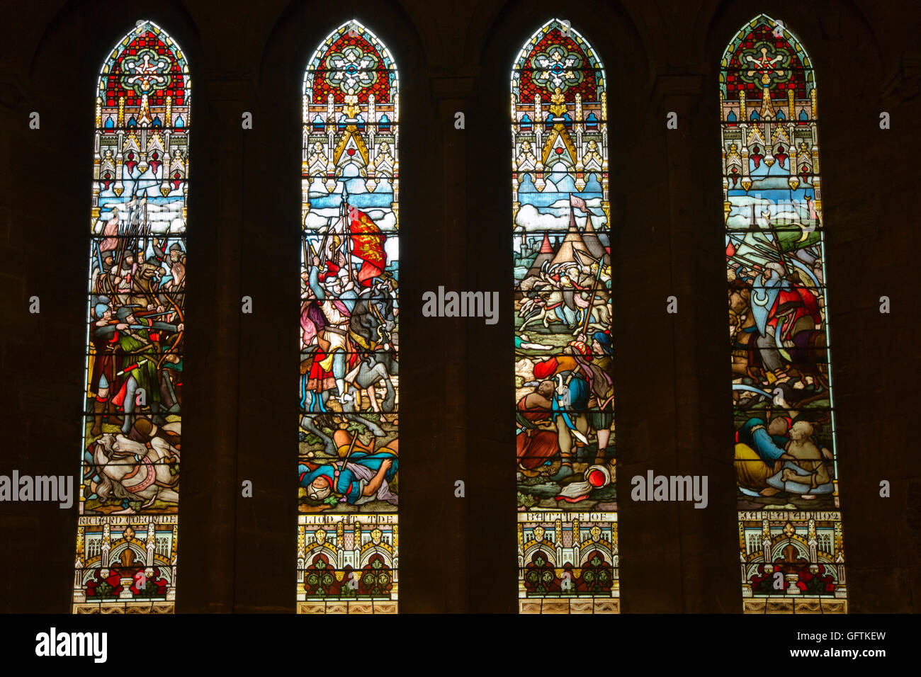 UK, England, Northamptonshire, Northampton, Church of Holy Sepulchre, Battle of Jaffa crusader stained glass windows - Stock Image