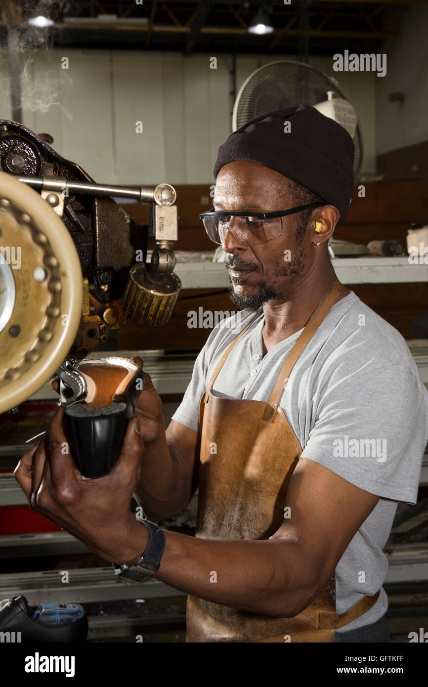 UK, England, Northamptonshire, Earls Barton, Barker's, worker Lloyd Jackson  welt stitching leather shoe - Stock Image