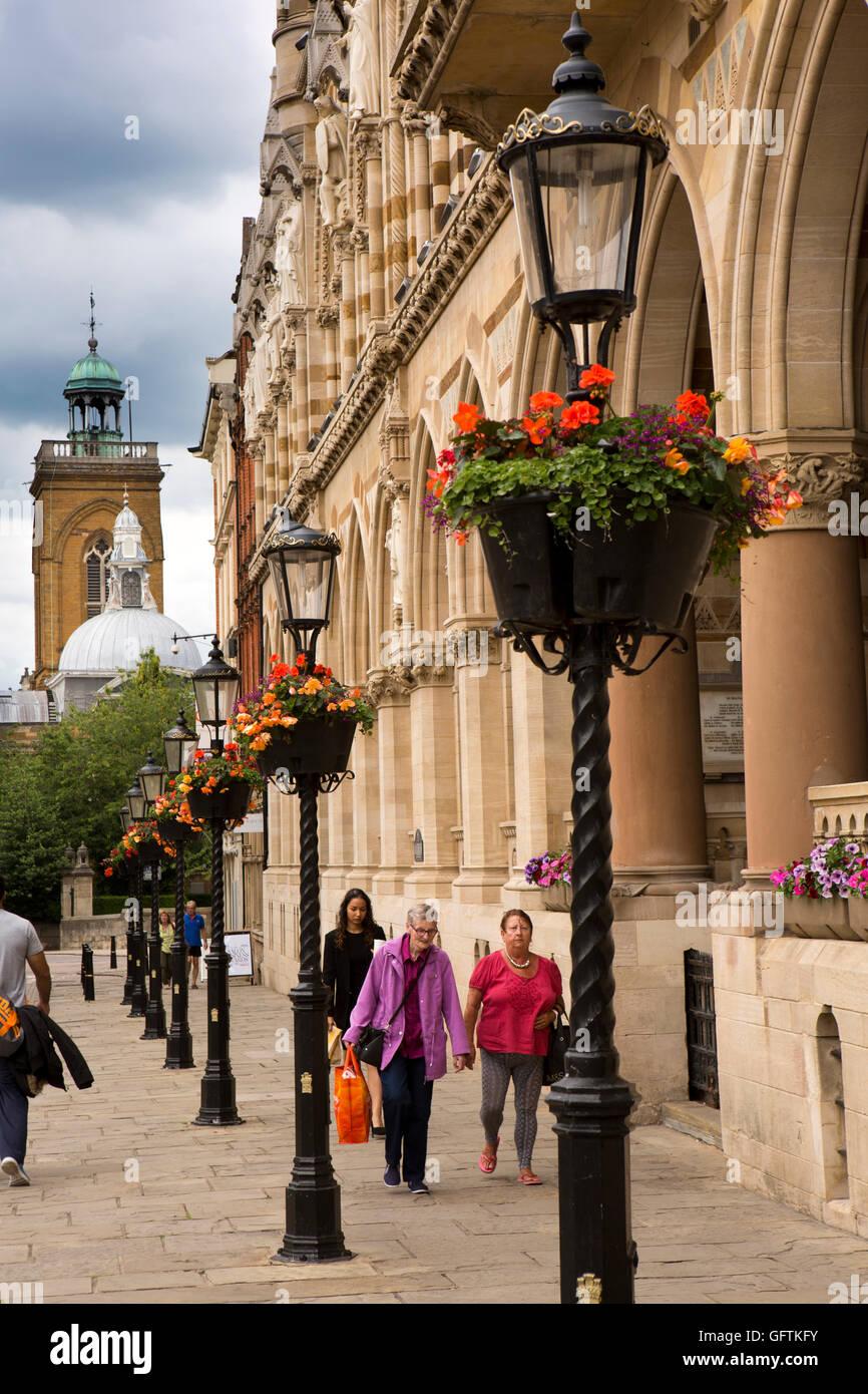 UK, England, Northamptonshire, Northampton, St Giles St, Hanging baskets on street lights outside Guildhall - Stock Image