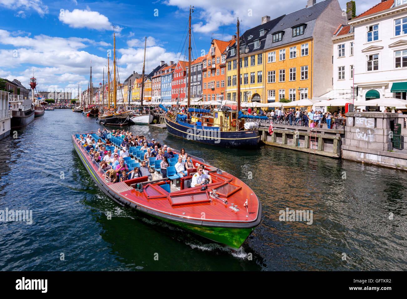 Excursion boat, Nyhavn canal, Copenhagen, Denmark Stock Photo