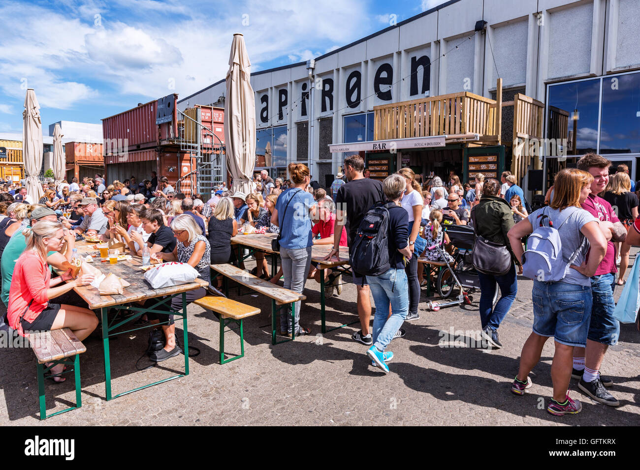 Outside seating at the new eatery and real street food market called Papirøen, Paper Island, Copenhagen, Denmark - Stock Image