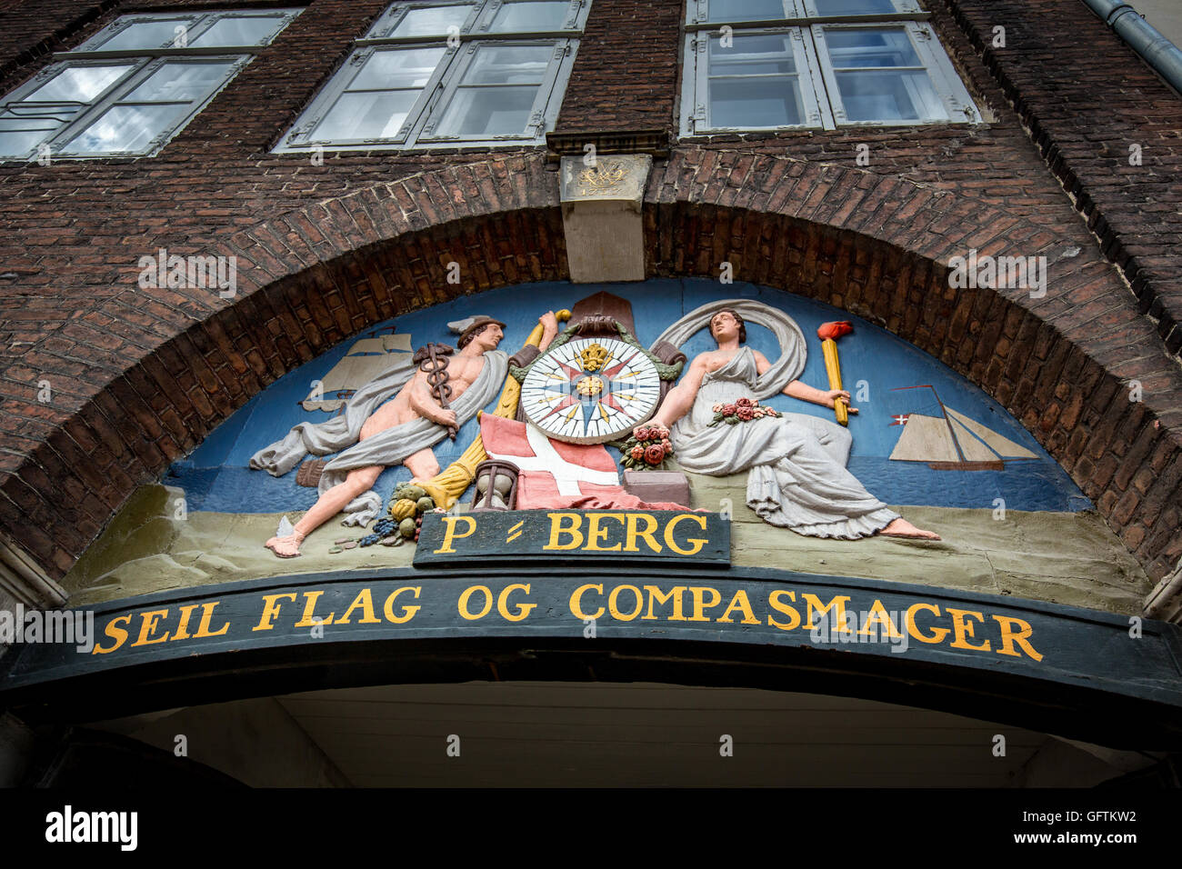 Old sign for a sail, flag and compass maker in Nyhabn, Copenhagen, Denmark - Stock Image