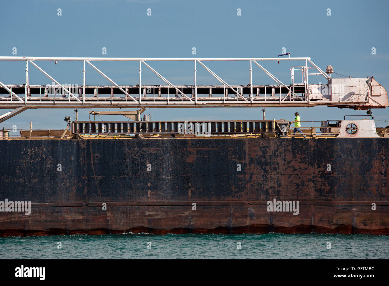 Detroit, Michigan - A crew member walks on the deck of the American Mariner bulk carrier sailing on the Detroit - Stock Image