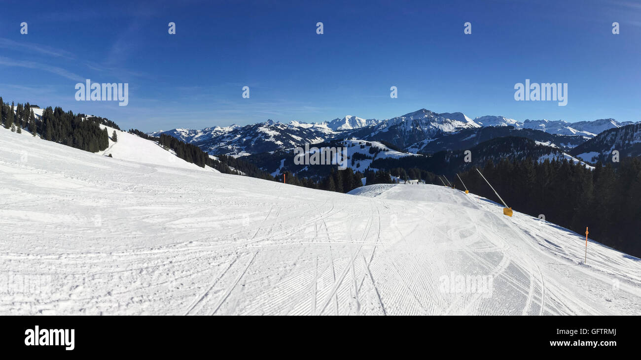 Well groomed and empty skiing slope in the Gstaad winter sports area. Cantons of Bern and Vaud, Switzerland. - Stock Image