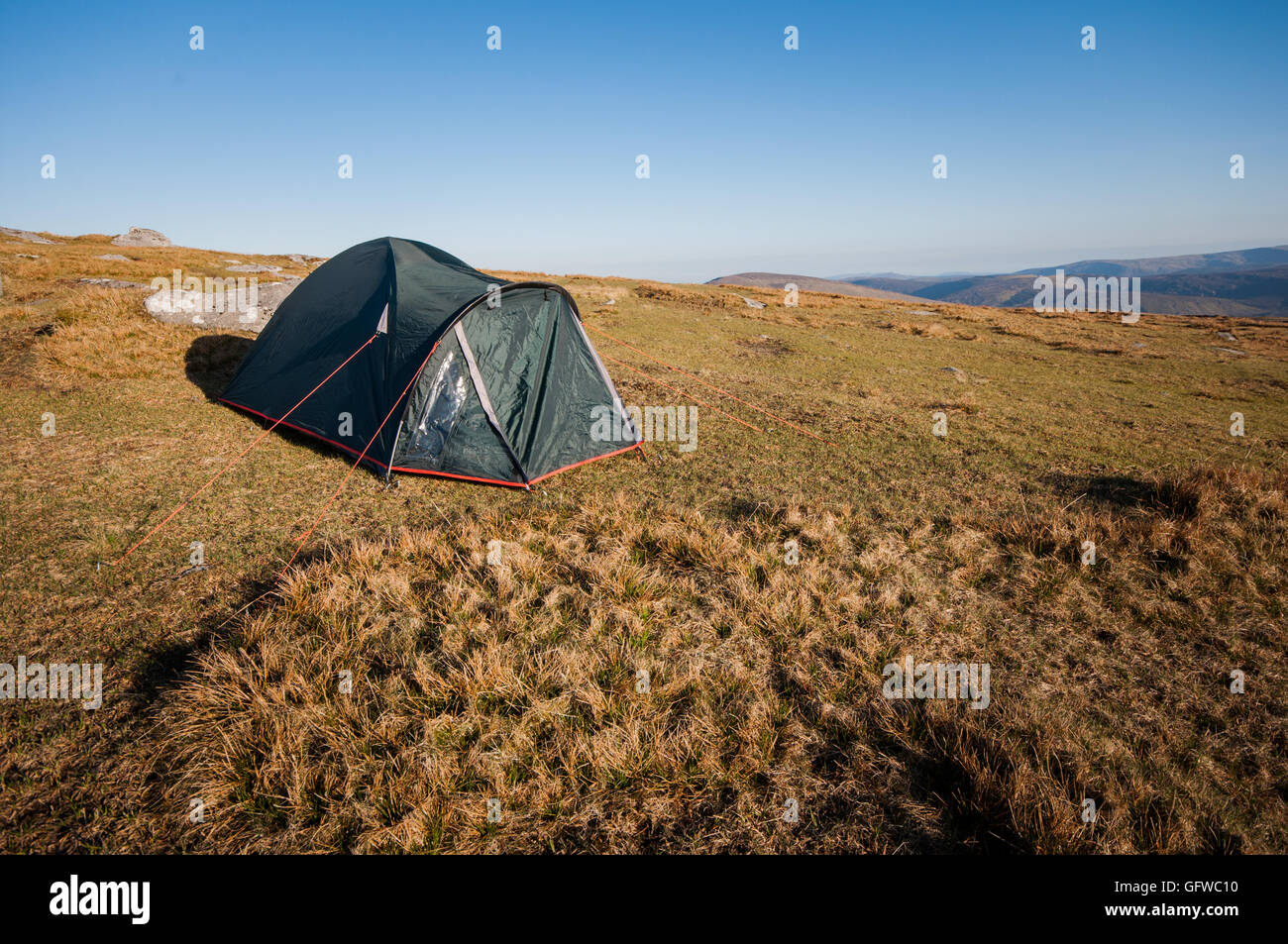Tent pitched on upland grassland in Wicklow mountains of Ireland - Stock Image