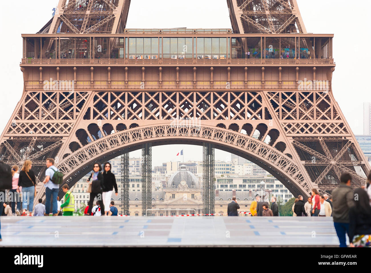 Paris Eiffel Tower, tourists walking on the terrace of the Trocadero overlooking the Eiffel Tower in Paris, France. - Stock Image