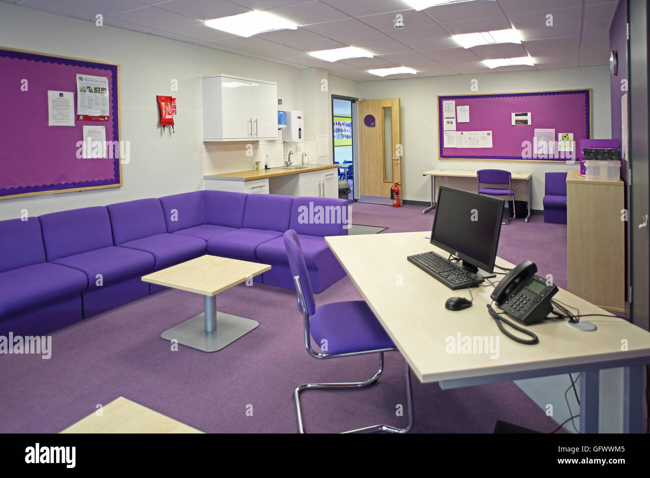 Office/administration area area in a new primary school. Shows administrators desk, seating area and kitchenette Stock Photo