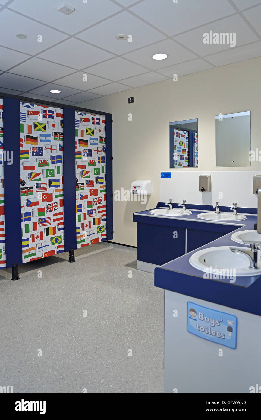 Toilets in a new primary school where the cubicle doors are decorated with the flags of the world - Stock Image