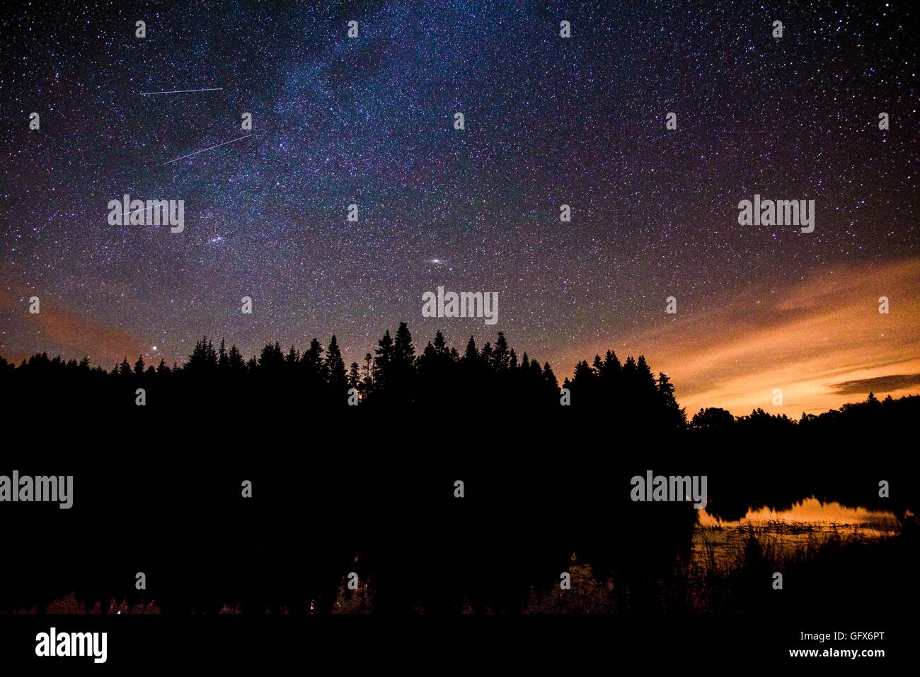 Milky Way over the lake at Faux-la-Montagne, France - Stock Image