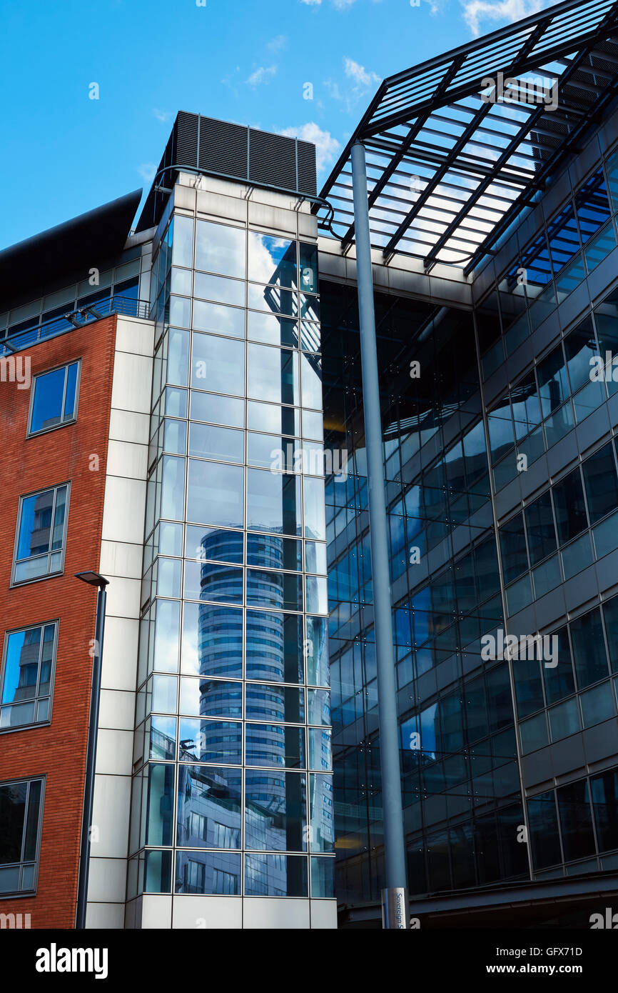 Bridgewater Place, Leeds reflected in windows of modern offices, Leeds - Stock Image
