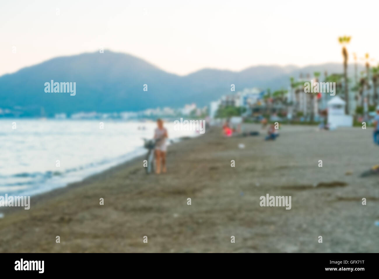 image of blur people on the beach for background usage in Marmaris, Turkey - Stock Image