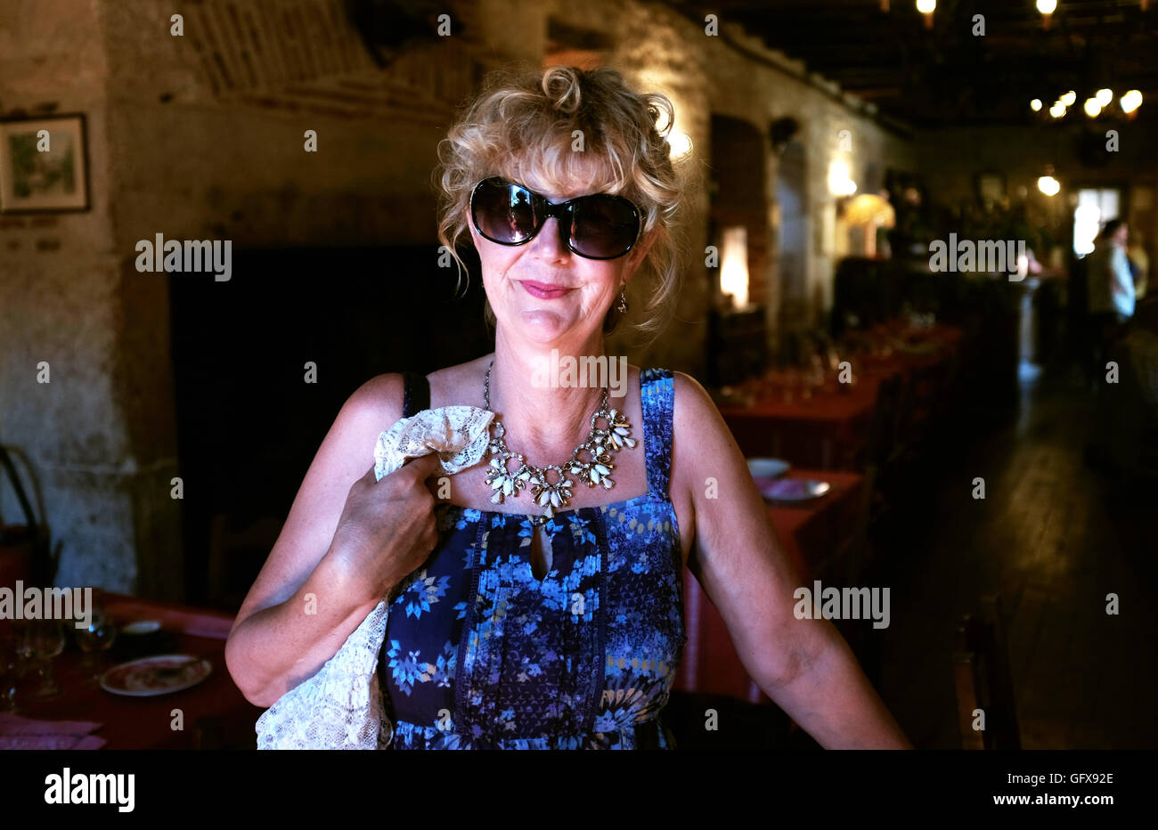 afcfa0cc620 Woman wearing sunglasses indoors at a restaurant in France Stock ...