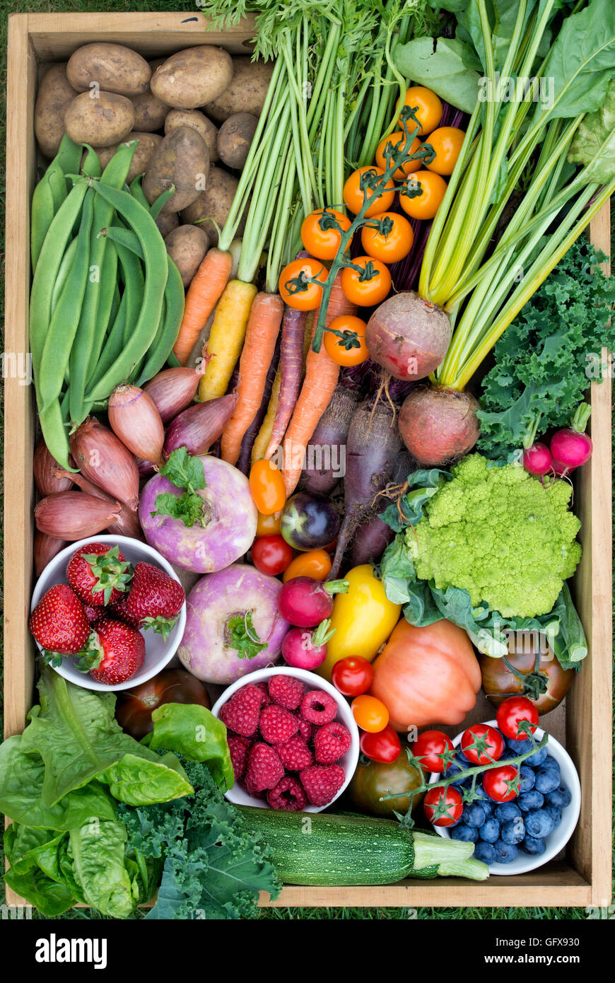 Wooden tray of harvested fruit and vegetables - Stock Image