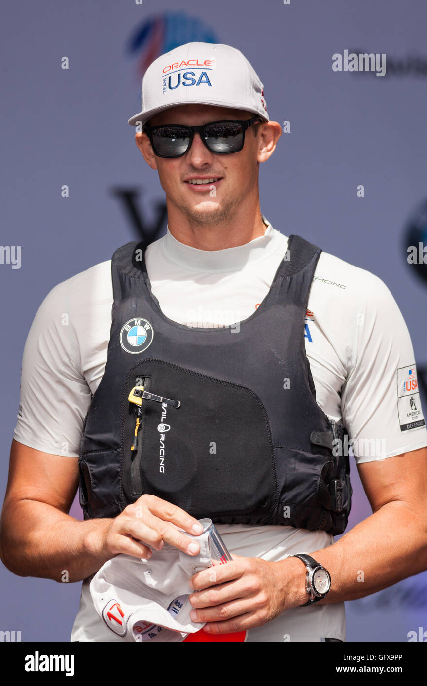 Oracle Team USA Wing Trimmer, Kyle Langford, at the America's Cup 2016 in Portsmouth, UK. - Stock Image