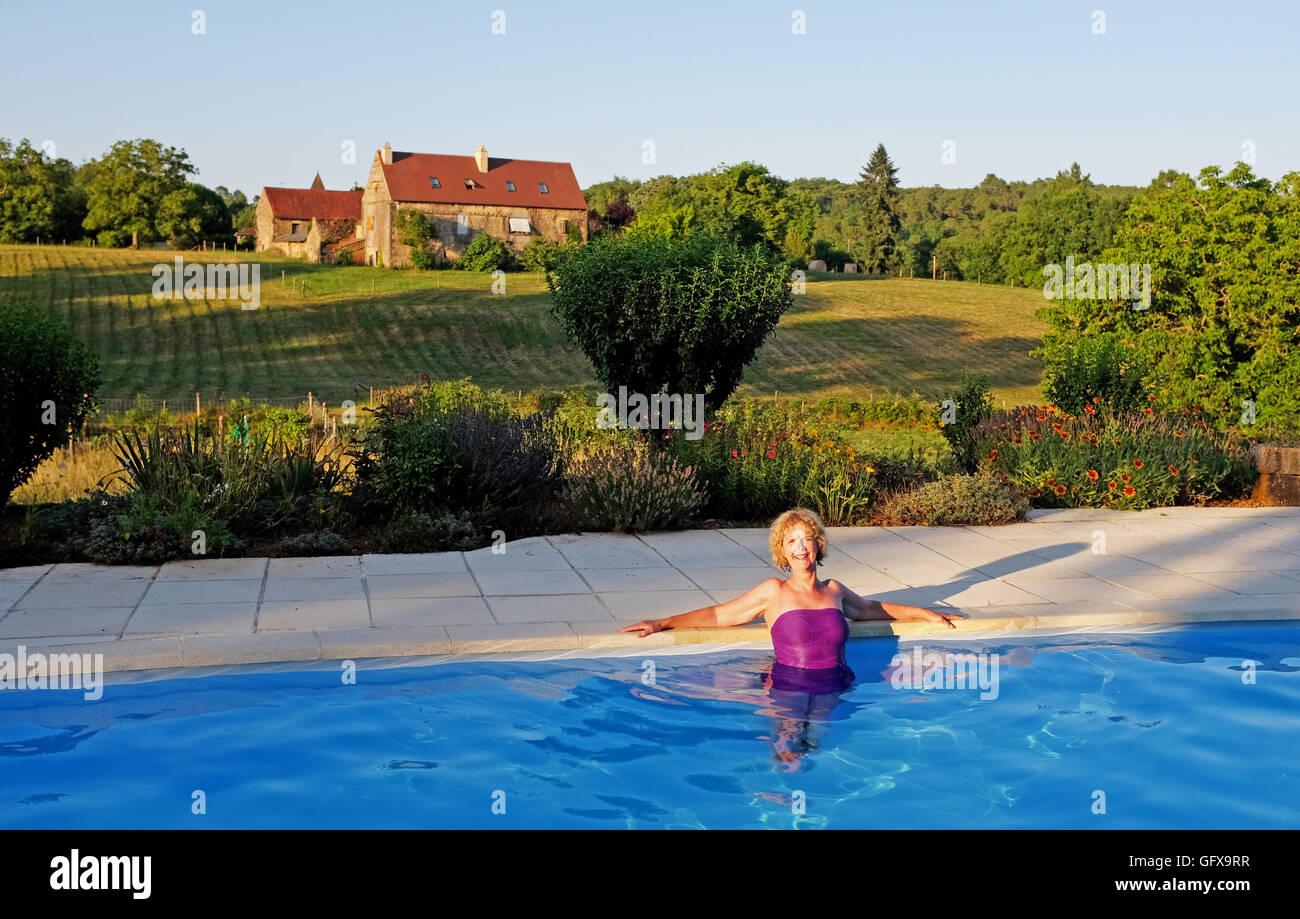 Mature Woman Enjoying Swimming Pool At A Beautiful Holiday Gite In Le Lot  Region South West France Midi Pyrenees July 2016