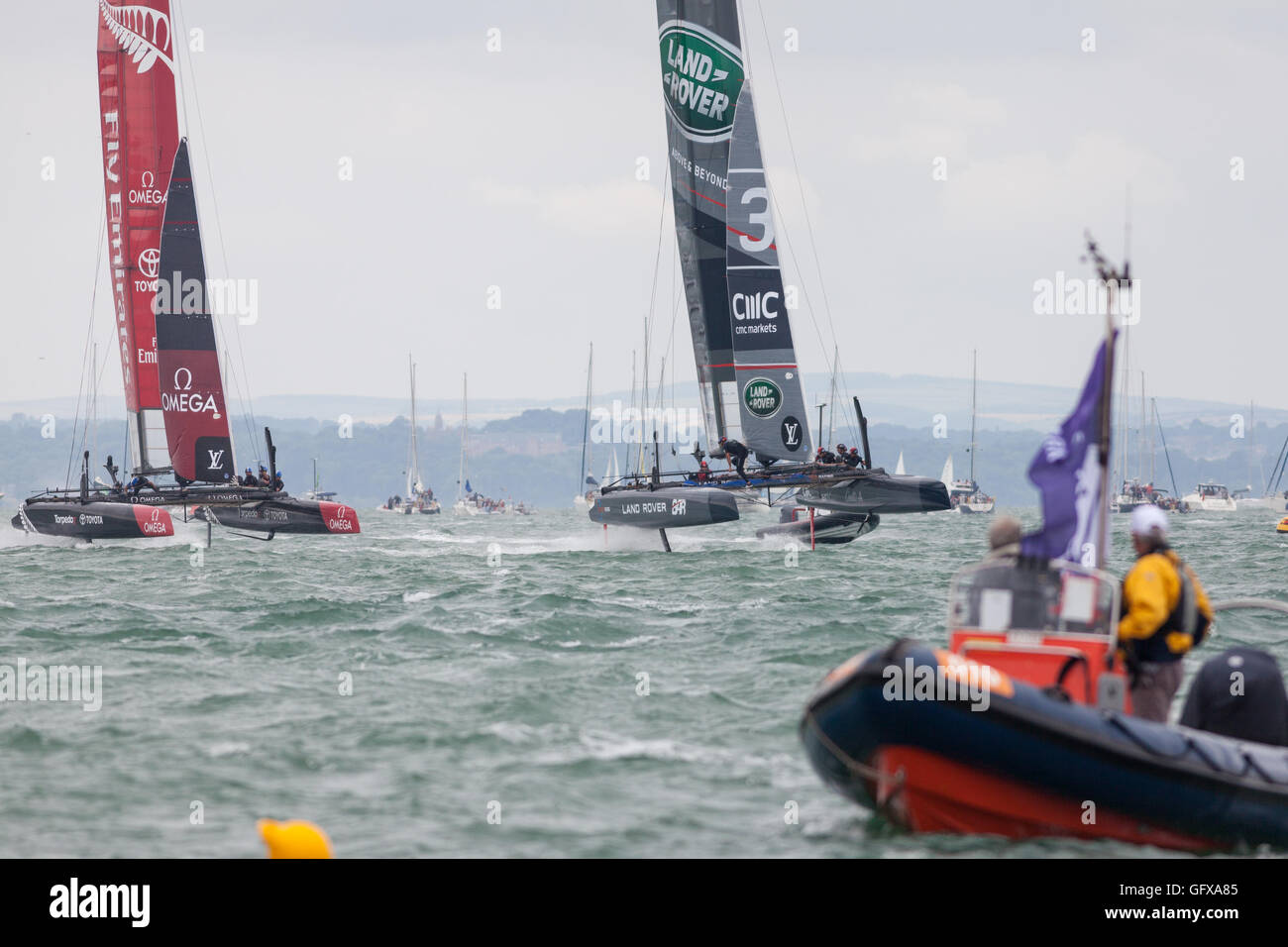 Oracle Team USA (left) Land Rover BAR (right) sailing teams in action at the 2016 America's Cup World Series - Stock Image