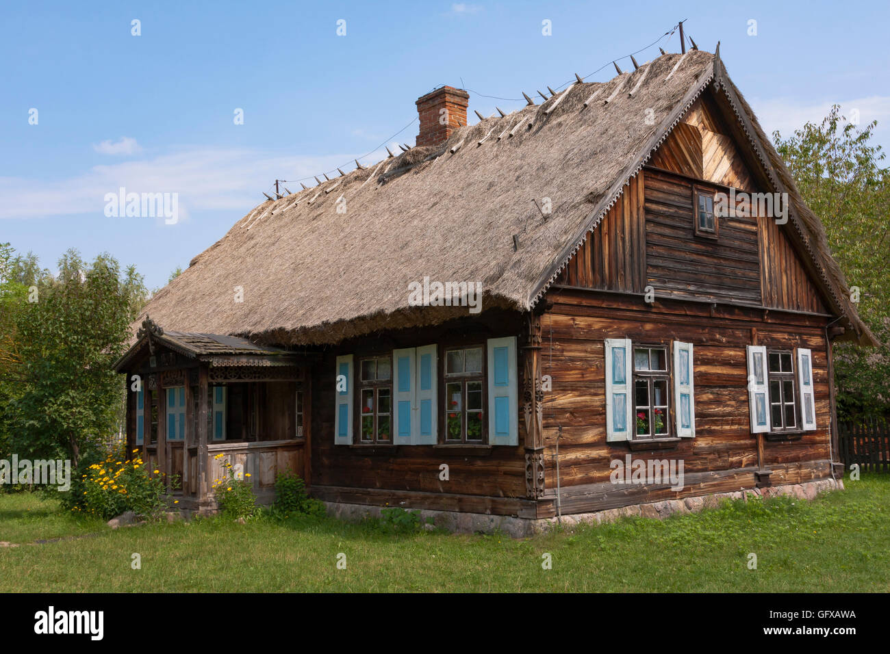 Old country cottage thatched roof in a natural environment - Stock Image