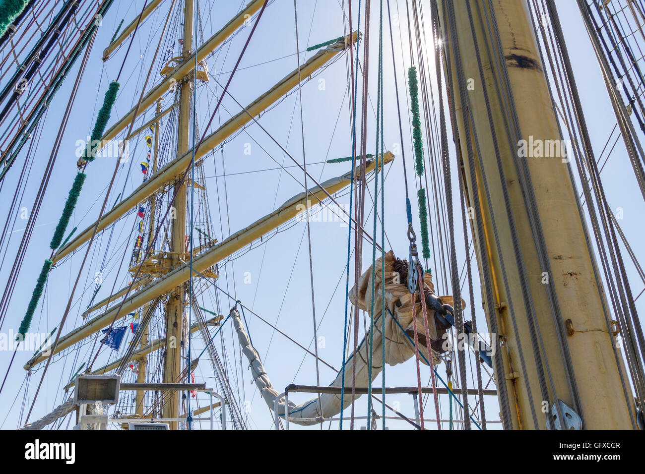 Detail shot of masts and rigging and the morning sun on square-rigged ship Mir (Peace) in Russian - Stock Image