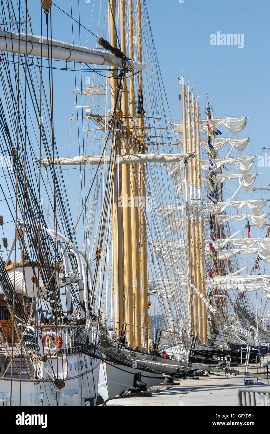 Tall Ships race Lisbon - in harbour - Portuguese ships Creoula and Santa Maria Manuela in foreground. - Stock Image