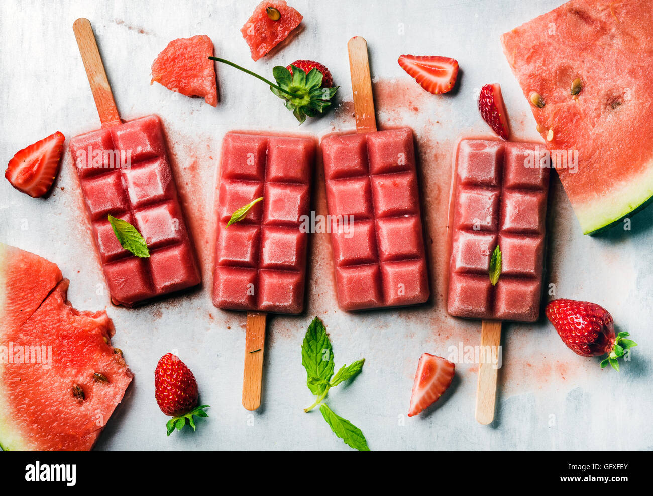 Strawberry watermelon ice cream popsicles with mint over steel tray background Stock Photo