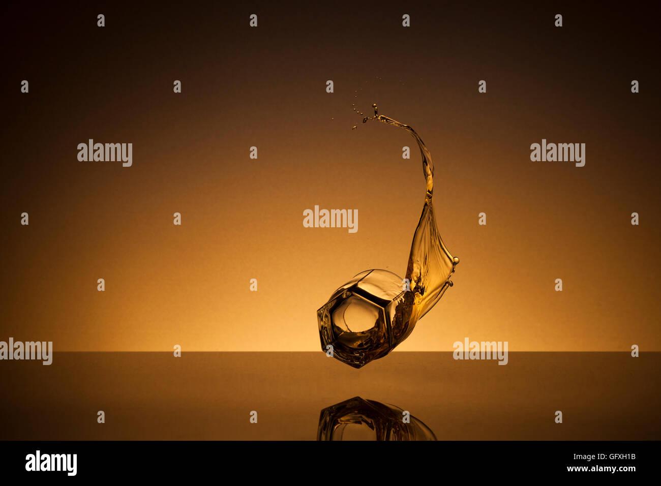 Flying glass of whiskey - Stock Image
