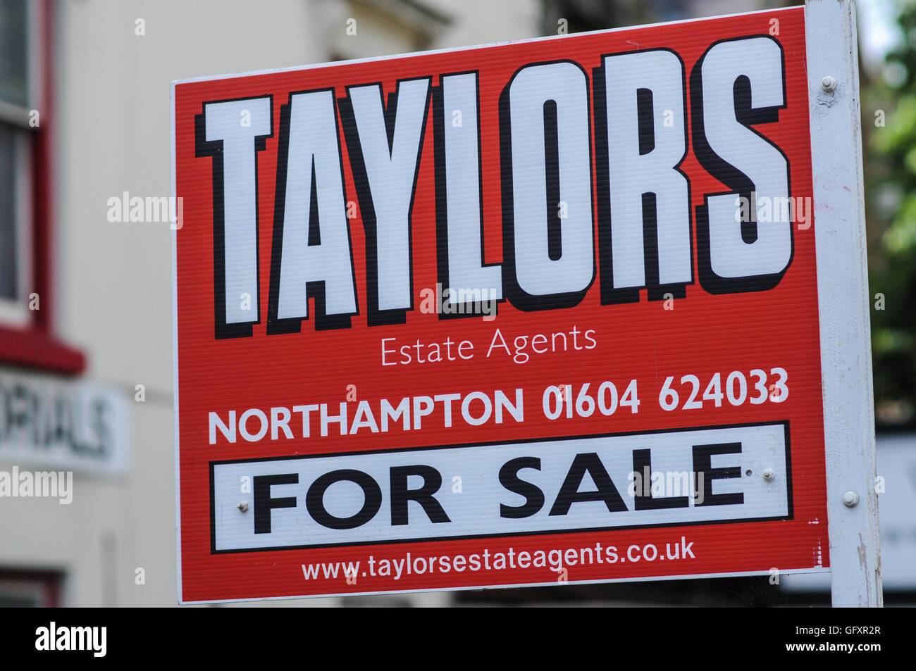 Estate agent sign house sale - Stock Image