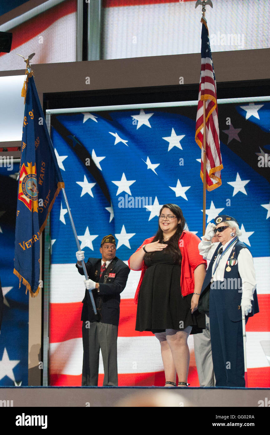 A 91 year old war veteran recites the Pledge of Allegiance before the opening day of the 2016 democratic national - Stock Image