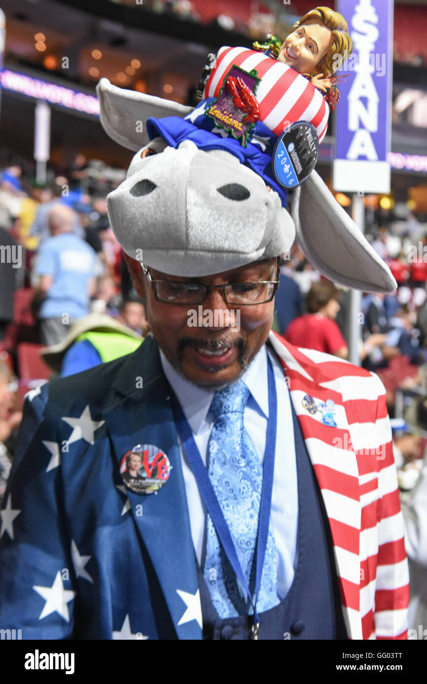 A Hillary Clinton delegate at the democratic national convention wearing a red white and blue USA clothing and a - Stock Image