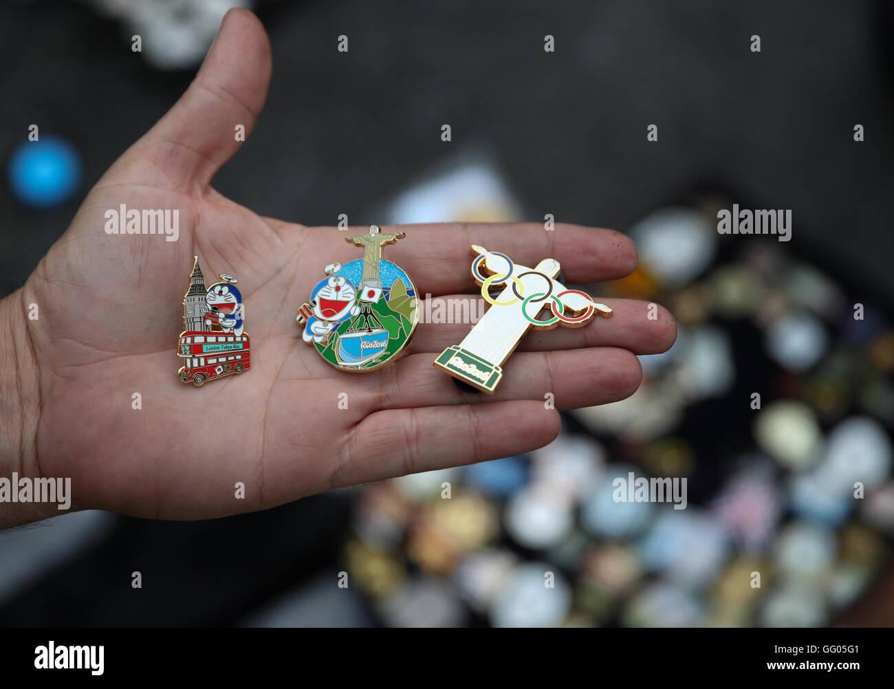 Barra, Rio de Janeiro, Brazil. 02nd Aug, 2016. Olympic pin trader Johnny Ioanidis of Greece presents his collection - Stock Image