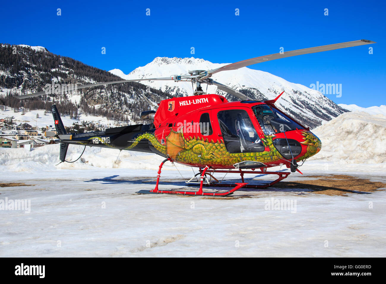 A amazing dragon on this Aerospatiale AS-350B-3 Ecureuil from Heli-Linth at Engadin Airport in Samedan/Switzerland - Stock Image