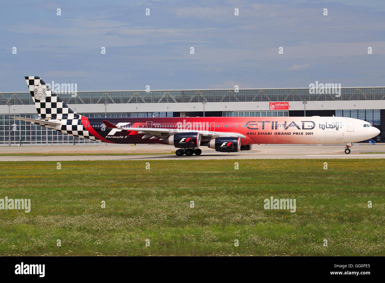 Munic/Germany August 9, 2014: Airbus 340-600 from Etihad Airways with Formula 1 special livery, ready to take off - Stock Image
