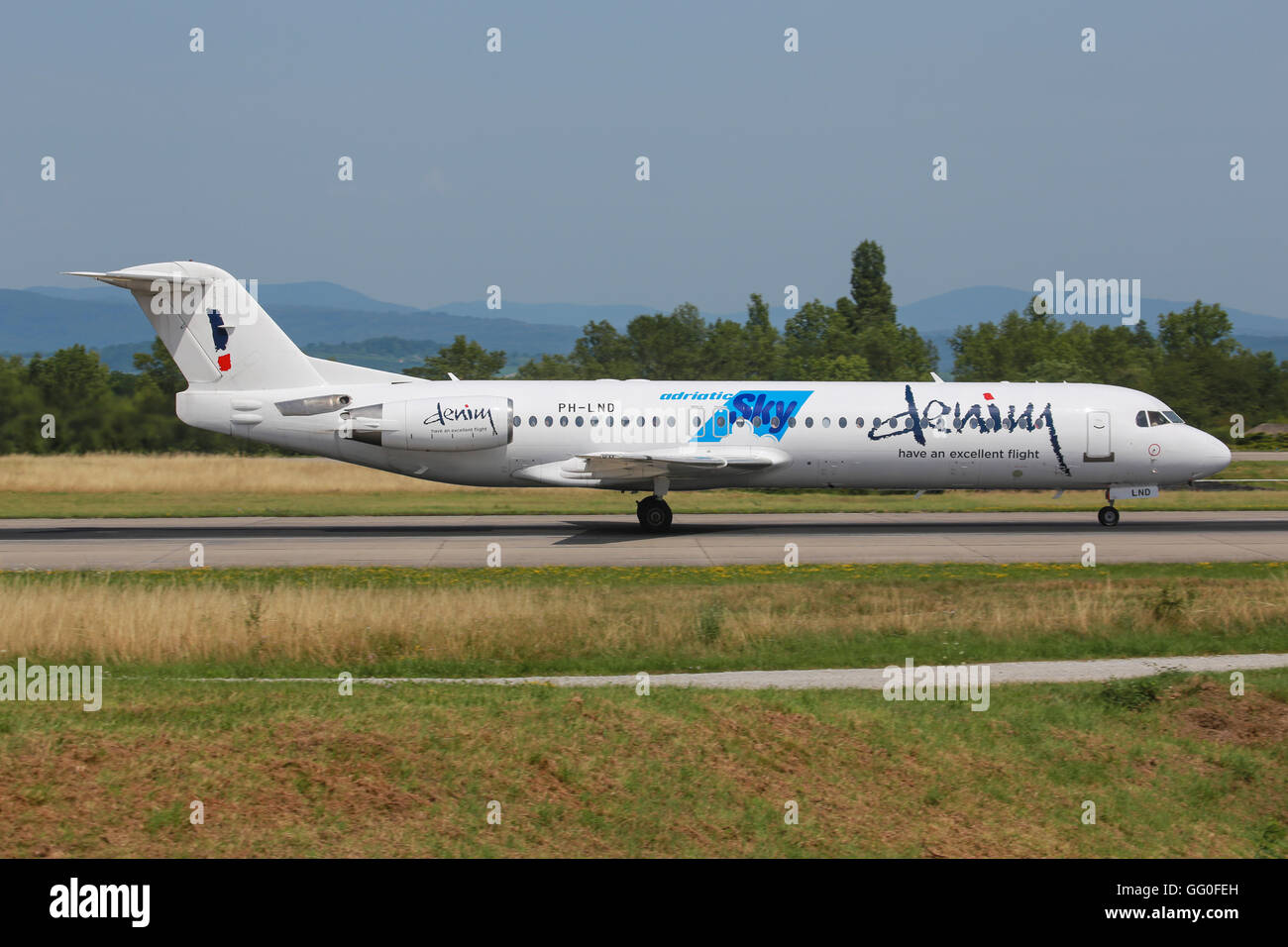 Genf/Switzerland August 5, 2015: Fokker from Demin Air  Genf Airport. - Stock Image