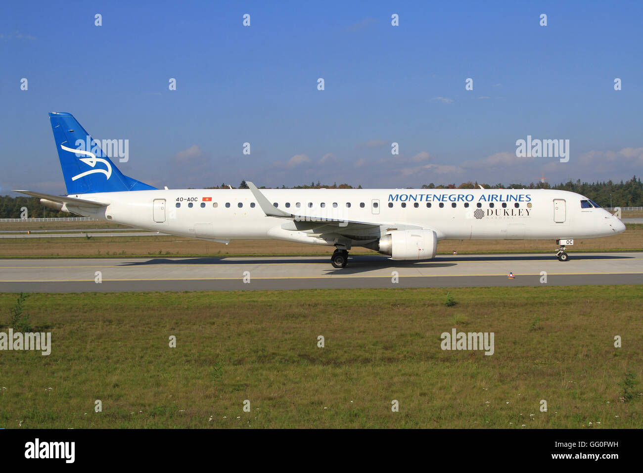 Frankfurt /Germany March 18, 2014: Embrear from Montenegro Airliners at Frankfurt Airport. - Stock Image