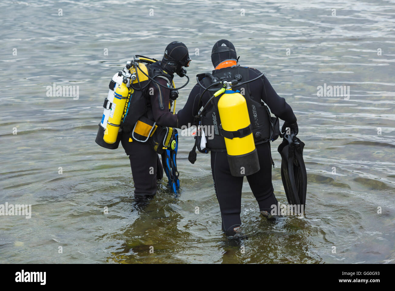 Two Scuba divers in the sea at Swanage in July - Stock Image