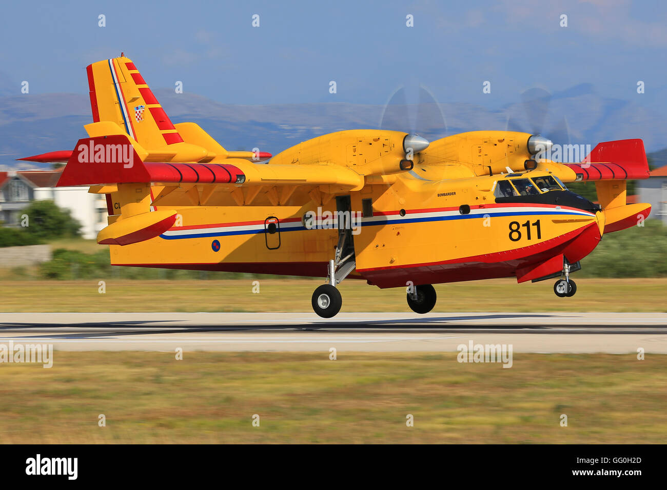 Split/Croatia July 22, 2014: Canadair CL-415 from Croatia - Air Force landing after fighting against a fire at Split - Stock Image