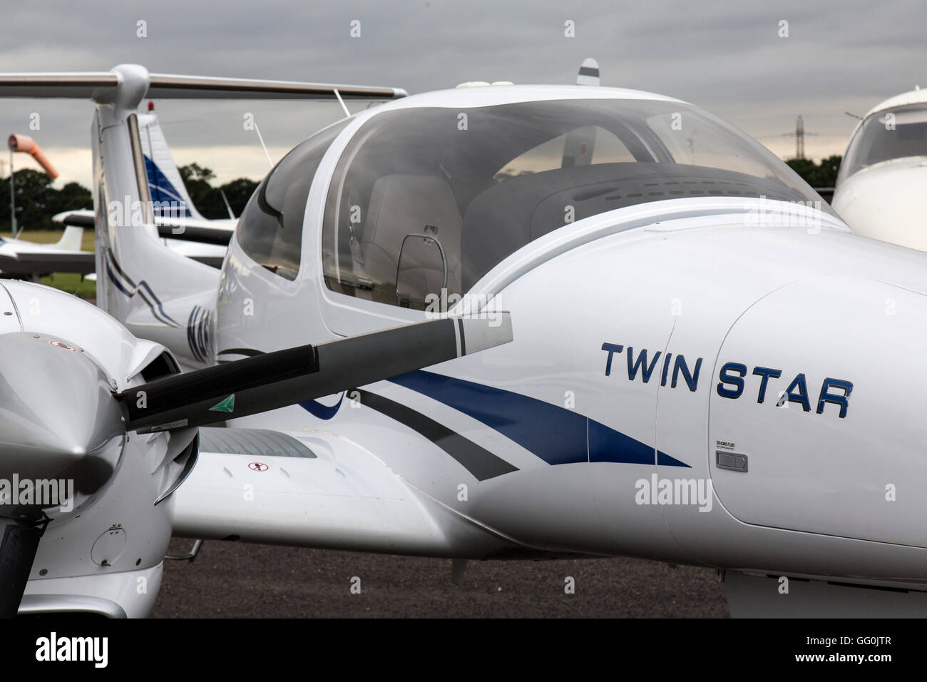A Diamond DA42 Twin Star, a four seat, twin engine, propeller-driven airplane manufactured by Diamond Aircraft Industries. - Stock Image