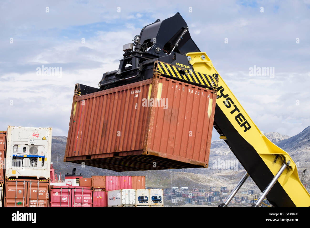 Hydraulic Hyster forklift truck lifting freight shipping containers in port. Atlantic Harbour, Nuuk Sermersooq West - Stock Image