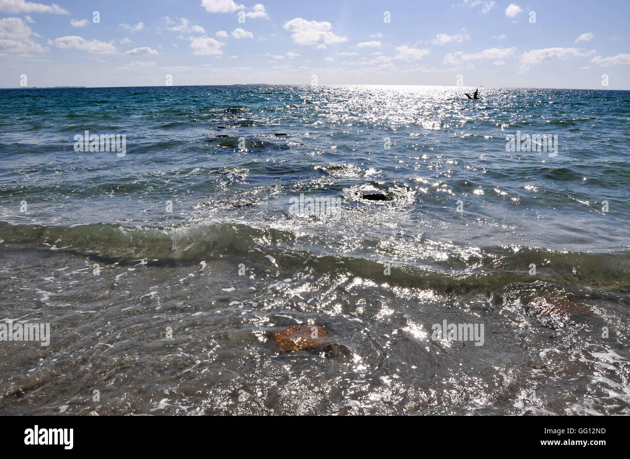 Glistening Indian Ocean seascape under a blue sky at the North Coogee Beach in Western Australia. - Stock Image