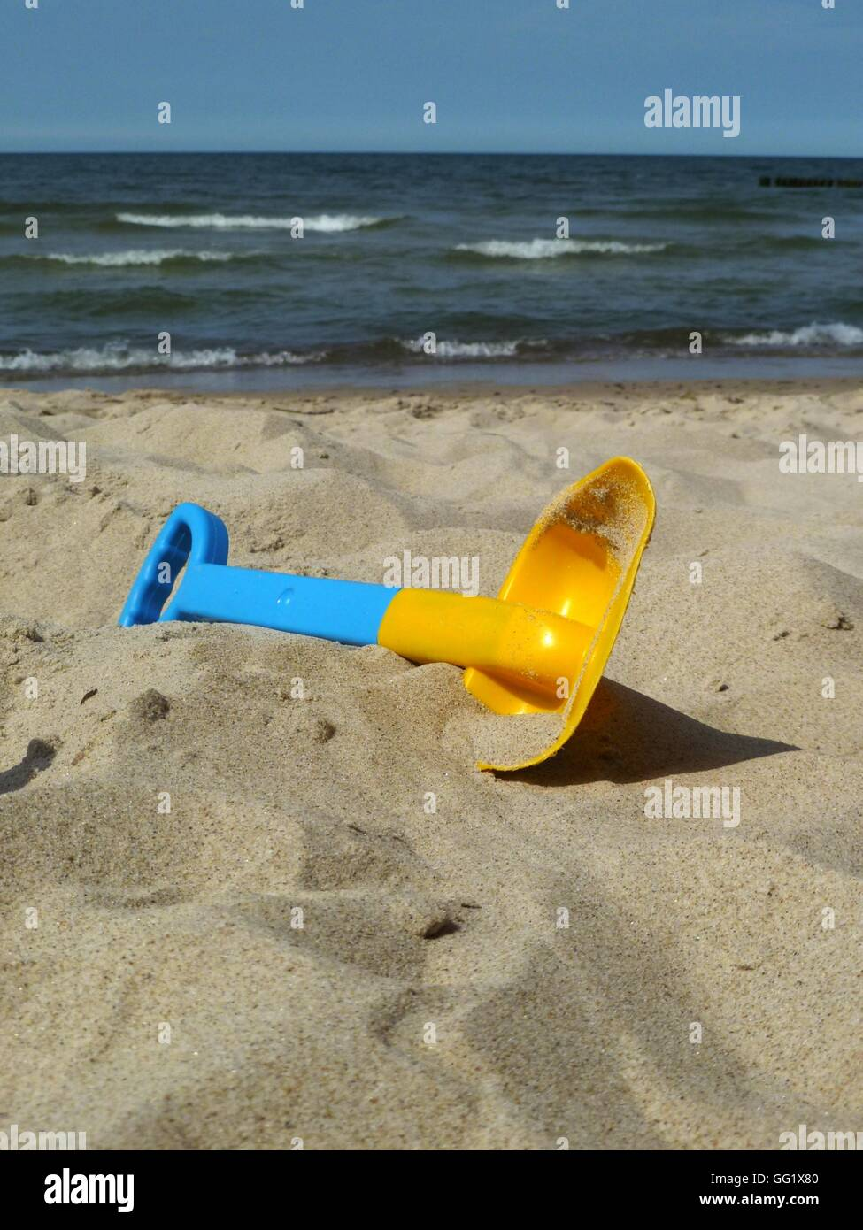 scoop the sand - Stock Image