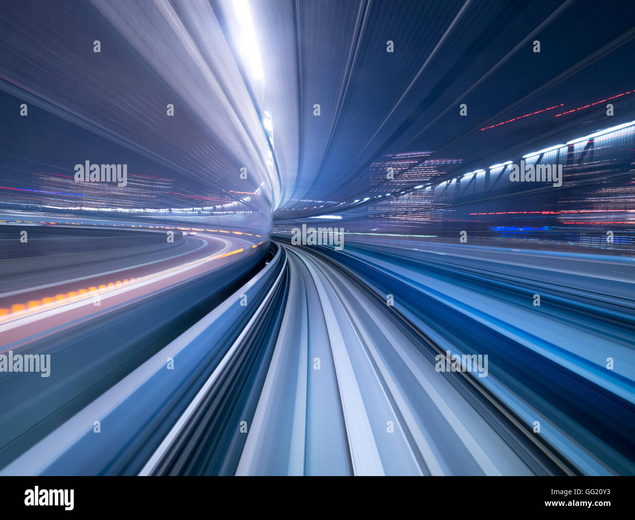 Motion blur of train moving inside tunnel in Tokyo, Japan - Stock Image