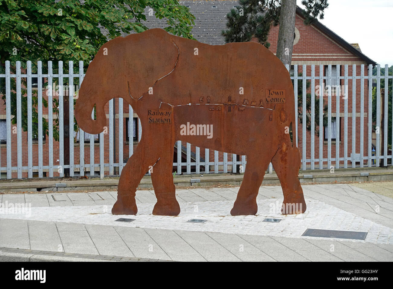 A steel elephant sculpture is a sign directing pedestrians to the town centre from Colchester North rail station, - Stock Image