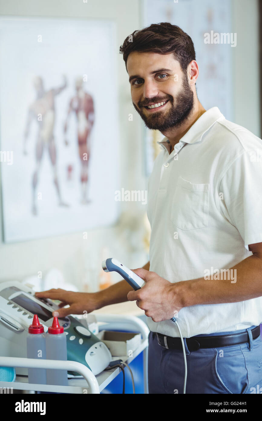 Physiotherapist using therapeutic ultrasound - Stock Image