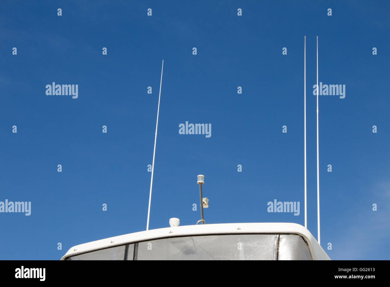 Antennas of a yacht for radio communication Stock Photo