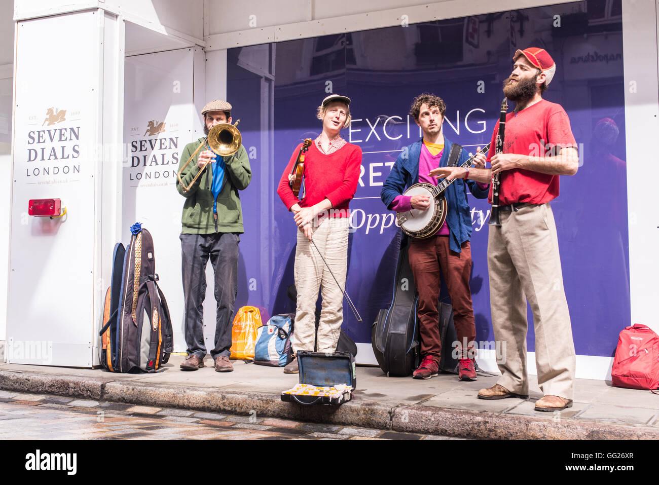 Quartet brass band busking during the Seven Dials street festival, London, UK - Stock Image