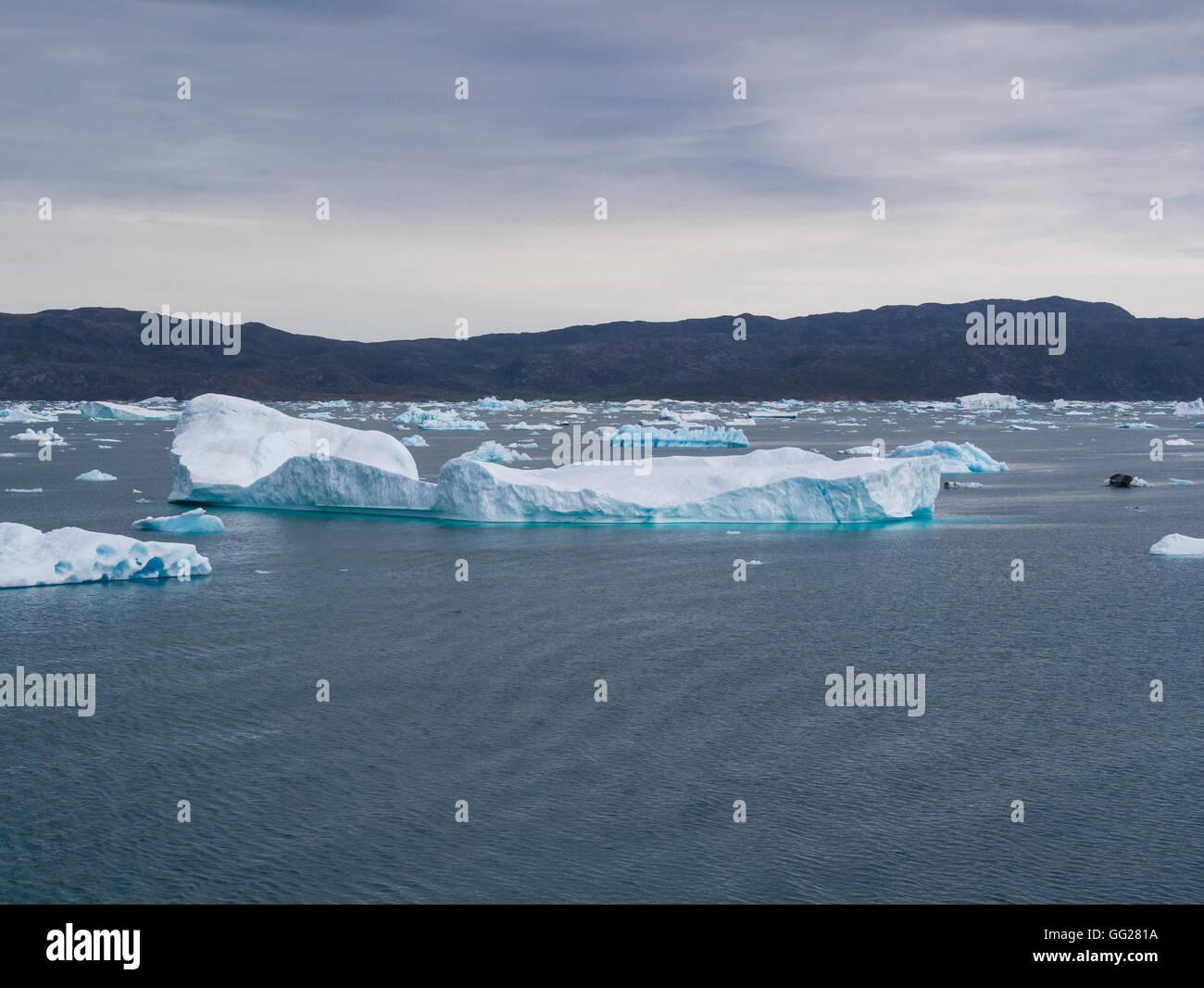 Cruising through icebergs along coast of Labrador Sea South West Greenland - Stock Image