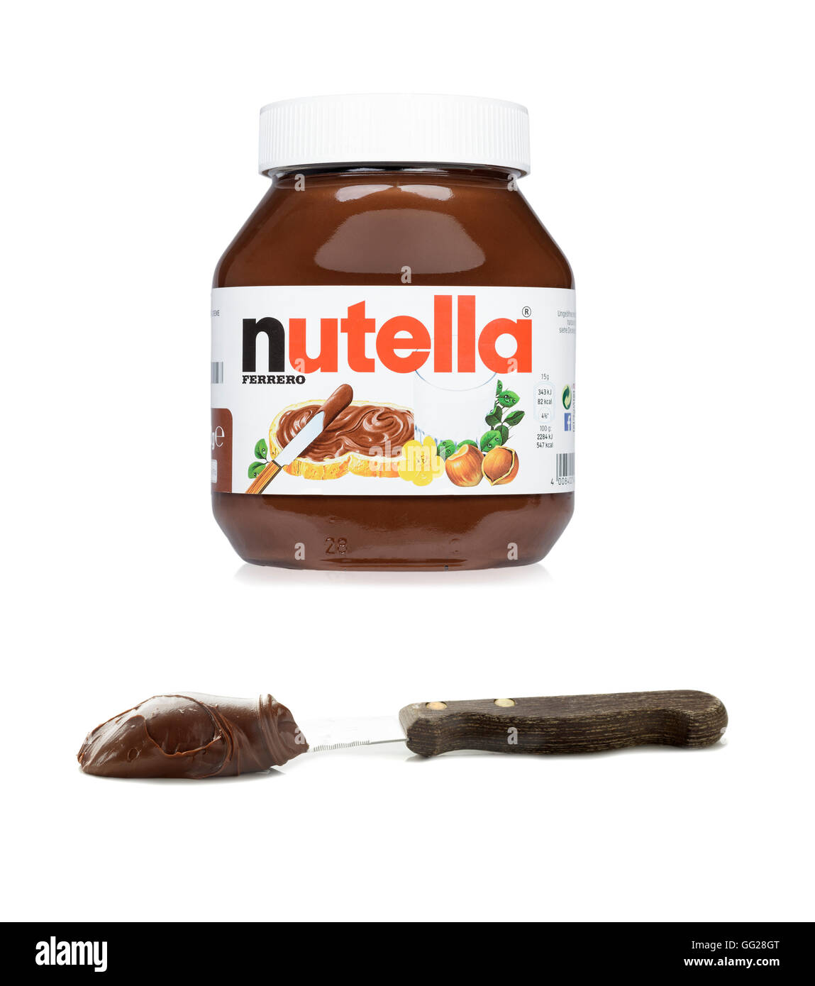 Nutella jar with spread on knife - Stock Image