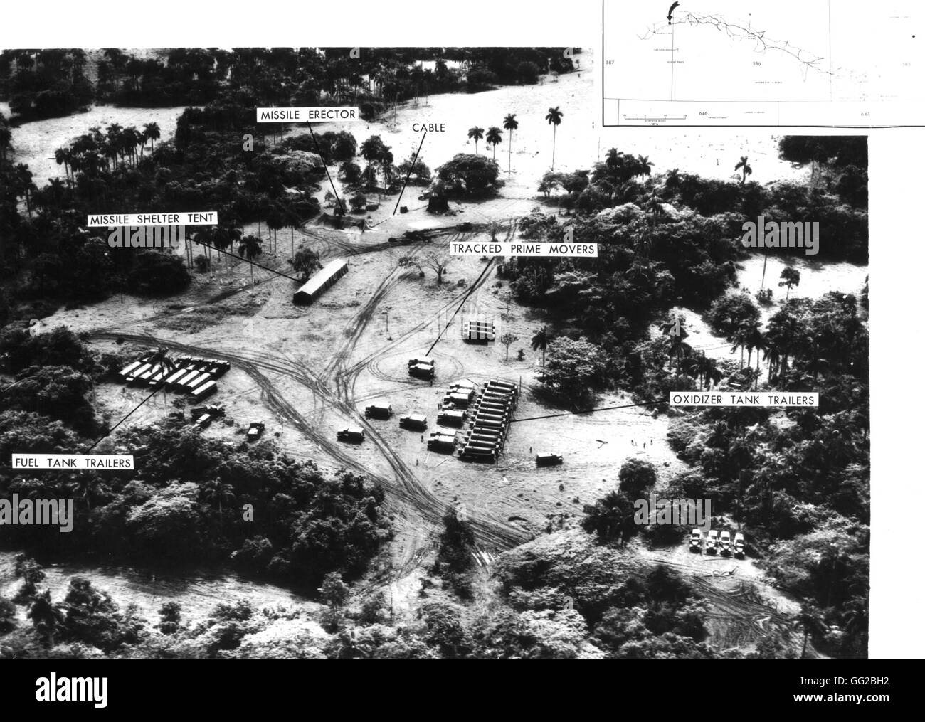 cuban missiles crisis san cristobal base in the foreground a row of vehicules and fuel tanks since october 14 a missiles shelter and another equipment