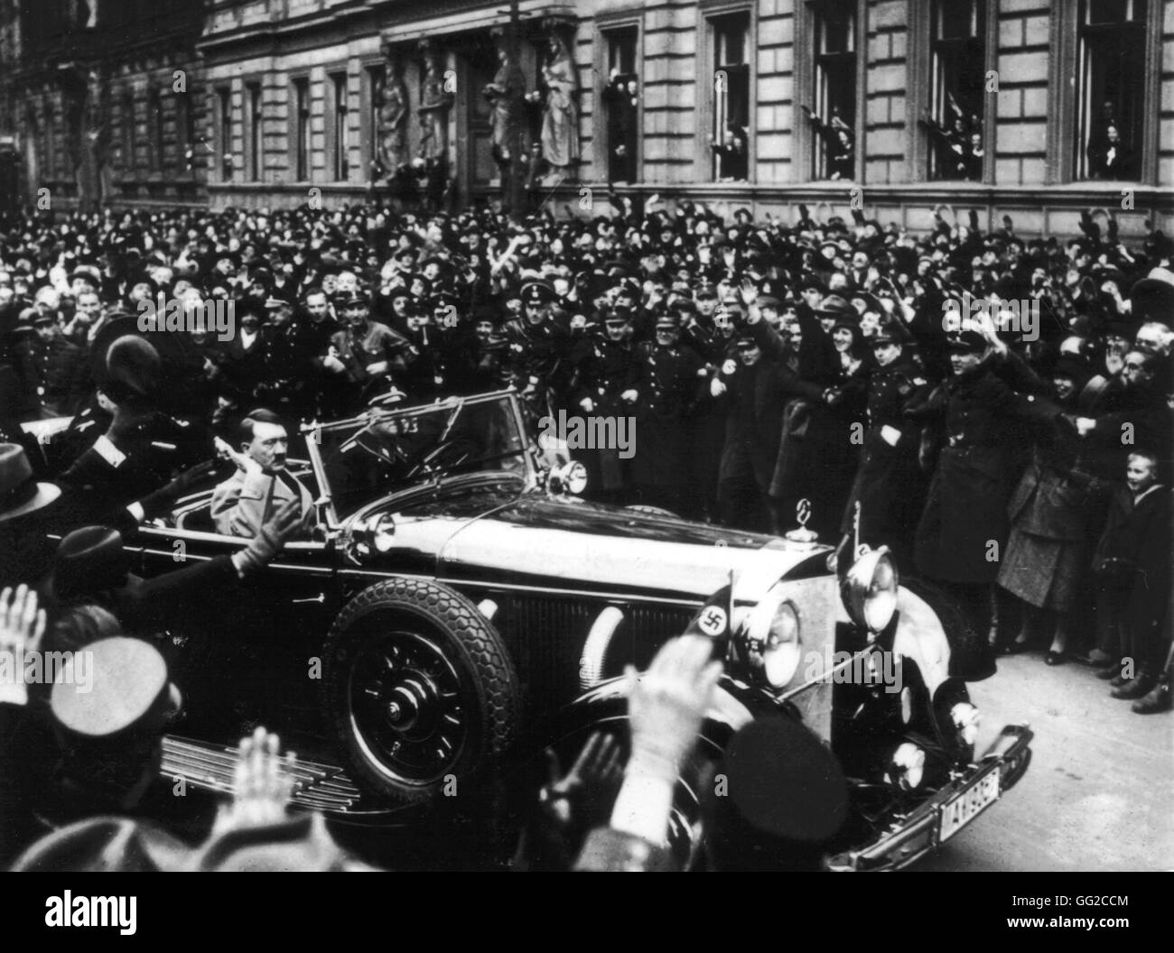 Hitler leaving the Reichstag through the cheering crowd January 30, 1934 Germany Paris. Bibliothèque nationale - Stock Image